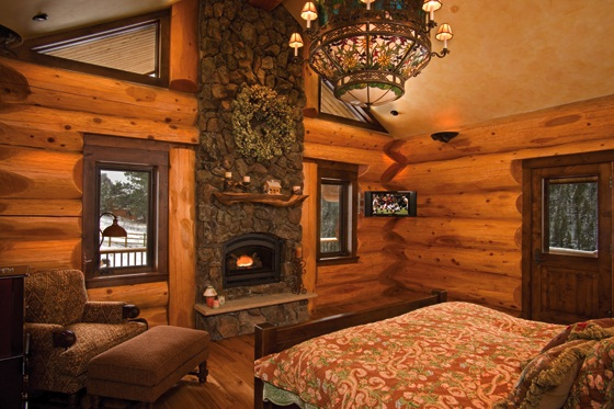 Amazing log home brimming with sophisticated electronic for Log home master bedrooms