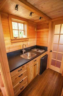 Cozy Tiny House Affixed to a Trailer or Secured to a