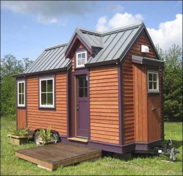 Cozy tiny house affixed to a trailer or secured to a for Cozy home designs